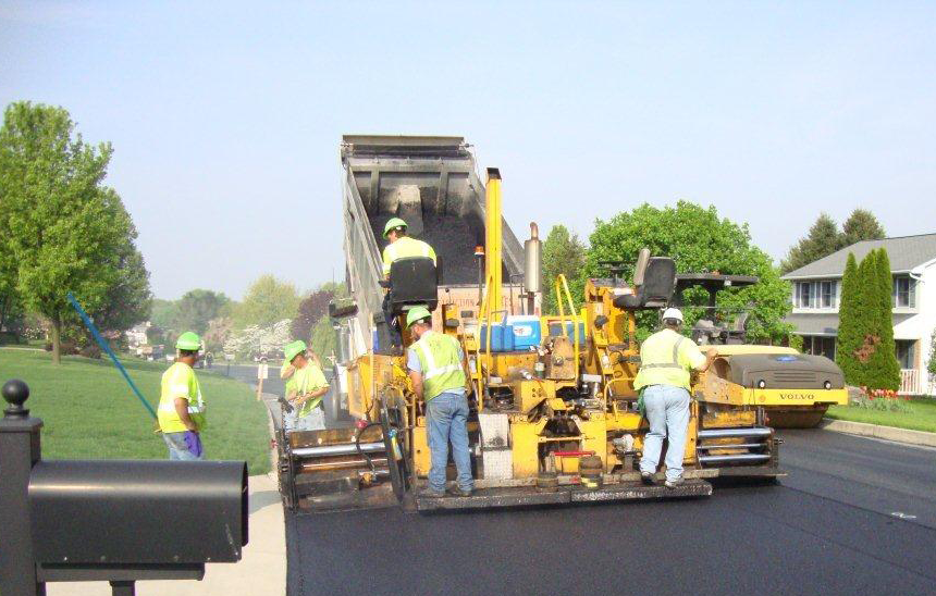 construction crew paving a road